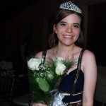 All smiles from Prom Queen, Jenny Anderson, as she accepts her flowers and crown with grace.